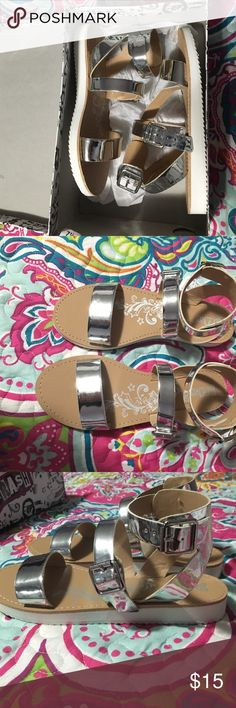 Metallic strapping sandals Silver colored sandals with buckles. Perfect condition. Never worn. New with tags. Got from another posher but didn't like the way they fit me. Size 7 1/2 Call It Spring Shoes Sandals