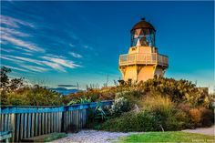 Manukau Heads lighthouse by Dmitri Ogleznev on Auckland, Lighthouse, Statue Of Liberty, New Zealand, Mansions, House Styles, Travel, Photos, Places