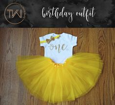 First Birthday Outfit Girl Yellow Belle by TheWhiteInviteGifts  This First Birthday Girl Outfit including a yellow tutu, one shirt and gold bow is the perfect outfit for her first birthday party and the added bonus of looking like Belle from the Beauty and the Beast is always a plus!