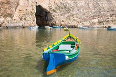 Luzzu fishing boat moored in the Inland Sea, Il-Qawra, Dwejra, Gozo, Malta