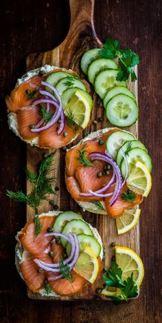 Bagels smeared with cream cheese, then piled high with lox, capers, onions and cucumbers.