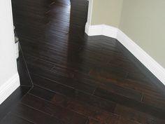 dark wood floors light walls and dark wood floors dark cabinets