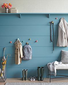 I like the wood panels leading up to a shelf in a fresh color.  This might work for the family room.
