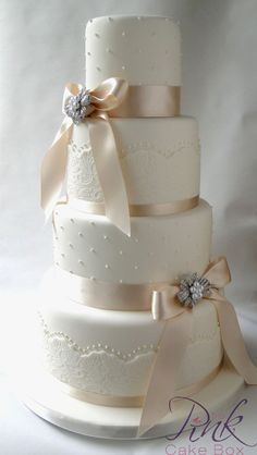 wedding cakes with lace and pearls