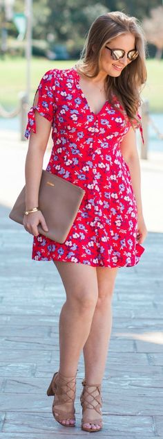 Red floral fit-and-flare dress w/ bow-tie sleeves from Express, Sam Edelman nude lace-up heeled sandals, Gigi New York Uber clutch in taupe, engraved gold bracelet, and pearl a& gold bracelet styled in a vacation-ready summer outfit idea by Florida fashion blogger Ashley Brooke Nicholas at Loews Portofino Bay Hotel. | cute dresses, preppy fashion, affordable style, floral dress, best summer outfits, spring style, summer style, summer fashion, best spring outfits, vacation outfits