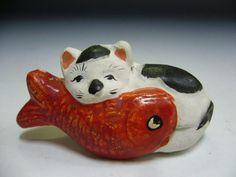 ceramic cat with fish
