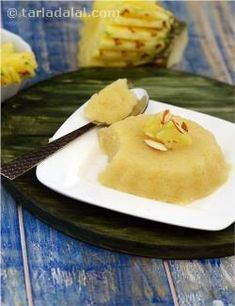 Pineapple Sheera  There+are+many+reasons+people+steer+away+from+making+sweets+at+home,+the+top+two+being+the+time+taken+to+make+these+sweets+and+the+risk+of+not+getting+it+right!+Here+is+a+tongue-tickling+dessert+that+overrides+both+fears.+This+exciting+Pineapple+Sheera+sends+your+taste+buds+into+a+tizzy+with+its+tangy+flavour+and+rich+consistency,+while+still+being+very+easy+to+prepare+and+ready+to+be+served+within+minutes!