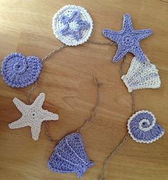 This is a pattern for four different sea shell motifs that can be used to decorate or can be put together in a garland.