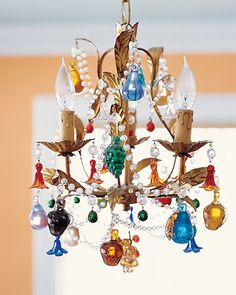 Love this chandelier. How funky and cool!!  Do with ornaments for holiday decor.