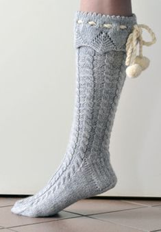 Cable knit pom pom knee high socks. Pattern in Swedish.