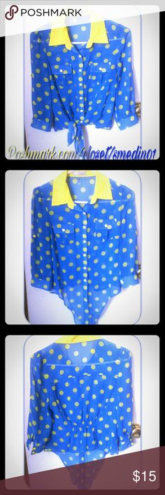 BLUE/YELLOW POLKA DOT BLOUSE This blouse features polka dots with buttons for closeure and front tie. 2 front pocket design. (NWOT) *  Only worn for 4 hours. Sorry no trades * but open for offers. Smoke free home. Ships same day. Thank you for checking out my closet :)   Content fiber  100% polyester Discovery  Tops Blouses