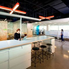 AOL's office features an open-plan layout with exposed ceilings, concrete floors and meeting areas built from oriented strand board.