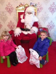 My gorgeous niece and nephew loving santa
