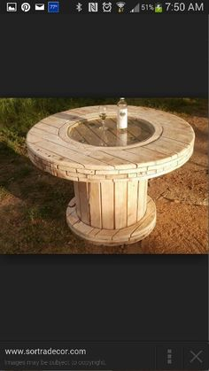 Wooden spool with glass center table