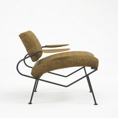 Dan Johnson, Enameled Steel and Walnut Lounge Chair, c1970.