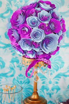 super cute idea for paper flowers... I wonder if these would be hard to make.