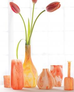 drizzle inexpensive glass bottles and vases with paint, then set the design by baking it at 350° for 30 minutes. Choose curvy vessels to help the paint pool in interesting ways.