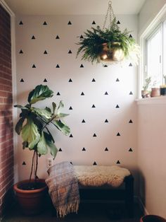 Mid-century modern mudroom #diy wall decals, plants and unique storage bins to stay organized
