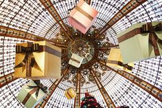 Cheese to try in winter: Mont d'OR try stuffing it with truffles. Galeries Lafayette Holiday Display, Paris by LostNCheeseland, via Flickr