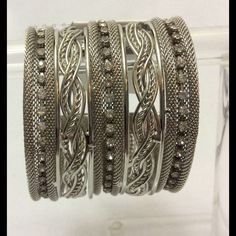 Cuff bracelet. Mesh silver toned metal with rhinestones cuff bracelet. Small part of the metal is not perfectly aligned as shown in picture 4. It's nothing but I had to mention. You have to closely inspect it to be able to see this imperfection. Jewelry Bracelets