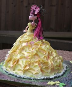 Beauty and the beast inspired birthday cake. Belle's dress on Monster High Draculaura doll.