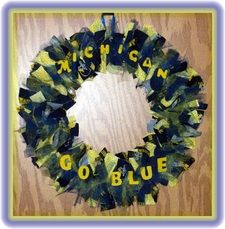 University of Michigan Wreath Wolverine Fans Rejoice!  Traditional Maize and Blue with U of M print fabric and tulle and hand-painted wood lettering.