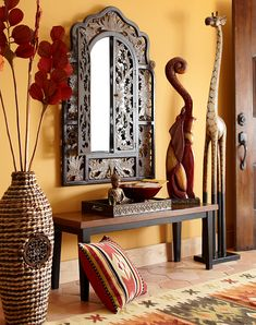 A bench serves as both seating and landing area for mail, keys, Pier 1 bags—you know, important stuff #AfricanStyle
