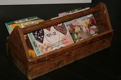 Old wooden tool box re-purposed as a magazine display