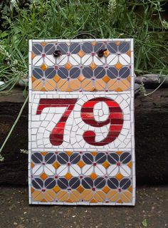 Mosaic house number - Nice andamento and cuts in the white behind the numbers.