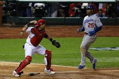 Carl Crawford of the Los Angeles Dodgers is tagged out at home by Yadier Molina in the third inning during game 1 of the NLCS. Cards won the game 3-2 in the 13th.  10-11-13