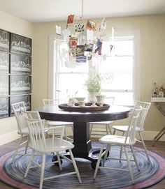 Those are thank-you notes adorning a Ingo Maurer chandelier. #diningroom #decorating