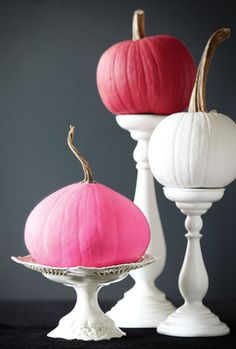 Painted pumpkins in pink and white, white pedestals