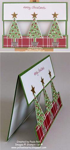 Carte au devant de carte évidé entre les arbres de Noël