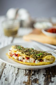 Pesto Chicken Egg White Omelette with Goat Cheese - This quick and easy, protein packed egg white omelette is mixed with chicken, creamy goat cheese and topped with pesto! It's a low carb and gluten free breakfast for busy mornings!   Foodfaithfitness.com   @FoodFaithFit