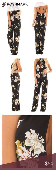 """BLACK FLORAL HALTER JUMPSUIT WITH SIDE POCKET BLACK FLORAL HALTER JUMPSUIT WITH SIDE POCKET           S.     M.  L Waist:24""""26""""30"""" Inseam:32.5"""" 33"""" 33"""" Bust:30""""32""""34"""" Black Floral Halter Jumpsuit with Side Pockets Black stretchy woven lining Imported Black floral non stretchy woven self Floral print in shades of Dusty Pink, Ivory, Olive and Sage Side pockets Zipper closure in back Halter double button closure Adjustable back spaghetti straps Self: 100% Polyester Lining: 100%…"""