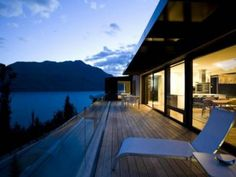 This luxurious Queenstown rental accommodation home with architectural award is situated on the beautiful Lake Wakatipu and it has a heated lap pool. New Zealand Architecture, Architecture Awards, Amazing Architecture, Hotels And Resorts, Best Hotels, Queenstown New Zealand, Lake Wakatipu, Luxury Accommodation, Luxury Travel