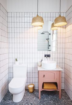 The hero of this bathroom is a bright pink vanity with marble top. The woven pendant lamps are repurposed IKEA baskets. The terrazzo flooring makes the space pop. Ikea Bathroom, Bathroom Plants, Bathroom Colors, Bathroom Sets, Bathroom Furniture, Modern Bathroom, Small Bathroom, Master Bathroom, Bathroom Designs