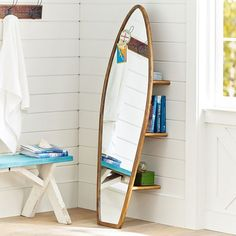 Taking a note from Pottery Barn Teen here for an adult house  -  a surf board mirror. Perfect for a beach house, kids room or not!