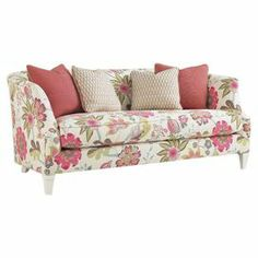 "Dress your home in feminine florals with this plush sofa. Wrapped in cotton upholstery, this chic design features a solid wood frame and 4 matching throw pillows.   Product: SofaConstruction Material: Hardwood and cottonColor: White, rose and greenFeatures: Four throw pillows includedDimensions: 32"" H x 78"" W x 37"" D"