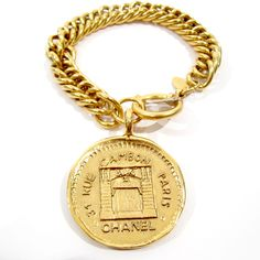 Chanel  Gold Chain and Large Coin Bracelet - $1,200.00
