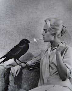 1962: A crow lights Tippi Hedren's cigarette