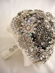 "Brooch this is the most beautiful brooch bouquet I've seen. Also love the ""i do"" on the handle. - how to create the perfect brooch bouquet, you may be wondering just what we mean. While many brooch bouquets are downright gorgeous, there is one way to . Broach Bouquet, Wedding Brooch Bouquets, Button Bouquet, Brooch Bouquet Tutorial, Broschen Bouquets, Dream Wedding, Wedding Day, Rave Wedding, Wedding Crashers"