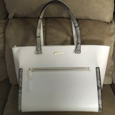 GORGEOUS KATE SPADE HANDBAG.  NWT Beautiful BRAND NEW with tags Kate Spade Brantley Parliament Square.  Never used.  Faux snake skin detail.  Large outside zippered pocket.  Inside features 3 pockets, one of which is zippered.  Great deal! No trades. kate spade Bags Shoulder Bags
