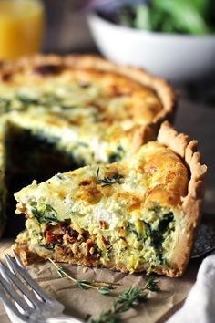 Deep-dish quiche packed with veggies and bursting with flavor! Tender and flaky crust filled with a fluffy egg center baked with sautéed leeks and spinach, sun-dried tomatoes, and creamy goat cheese.
