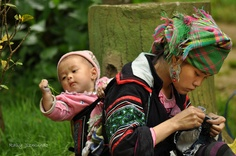 H'mong ethnic-mother and child in Vietnam, by jkasmot, via Flickr  (check out the baby who has grabbed ahold of a fist full of grass)