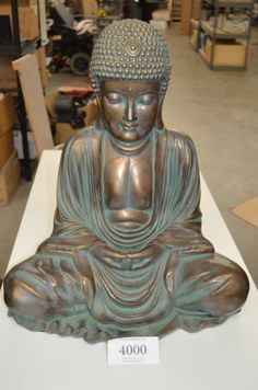 Sitting Buddha - display ornament 23in tall 20in wide material made of unknown