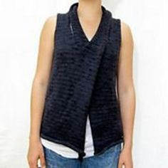 Adrian is a simple rolled-edge vest with a twist. It can be worn open but when the collar is crossed and slipped over the head it closes the vest and forms a shawl collar. by cocoknits