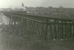 A CPR steam train traverses the High Level Bridge on its way to Calgary