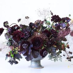 So, this shows the scabious, blackberries and dahlia - it's too dark, but you can see how adding some lighter wines, the shocking orange and blue could really bring it to life. Black floral arrangement by Tulipina