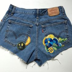 """One-of-a-kind Embroidered Vintage Levi's Hand-embroidered. Back patch. Garment specs (taken flat): waist 14 1/2"""". Hip 18"""". Inseam 2 1/2"""". Rise 10 1/2"""". Levi's Jeans"""